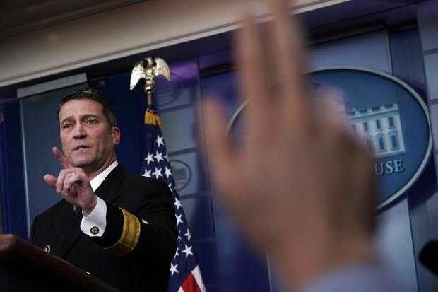 Dr. Ronny Jackson, the White House doctor, takes questions from reporters on Tuesday at the White House. Jackson discussed the details of President Donald Trump's physical the week before.
