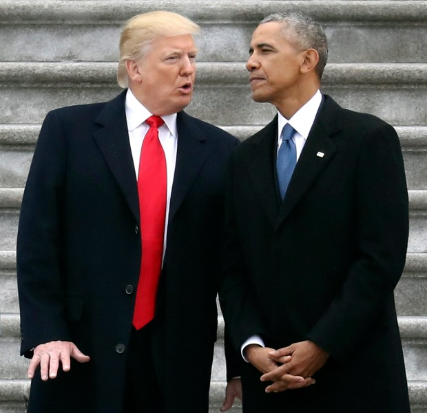 In this Friday, Jan. 20, 2017, file photo, President Donald Trump talks with former President Barack Obama on Capitol Hill in Washington, prior to Obama's departure to Andrews Air Force Base, Md. Trump relentlessly congratulates himself for the healthy state of the U.S. economy. But in the year since Trump's inauguration, most analysts tend to agree on this: The economy remains essentially the same sturdy one he inherited from Obama.