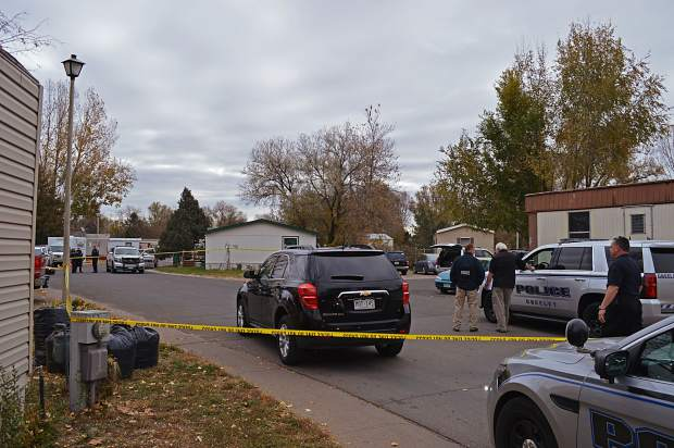 Greeley police talk at the scene of an officer-involved shooting Oct. 28, 2017. After an investigation by the Critical Incident Response Team, four officers who shot and killed Danny Sanchez, 40, were cleared of any wrongdoing.