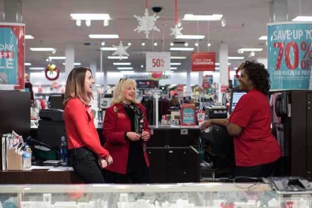 Co-workers share a laugh with Barbara Cake (cener) behind the jewelry counter at J.C. Penney in Hermitage, Pennsylvania on December 23, 2017.