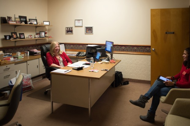 J.C. Penney general manager Sharon Loughner meets with floor managers in her office in Hermitage, Pennsylvania.
