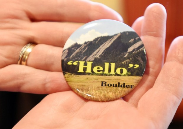 """Jenny Doyle is distributing these """"Hello"""" buttons to remind her fellow Boulderites that while Boulder has been named the nation's happiest city, it's not always the friendliest."""