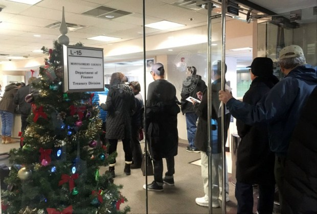 People wait in line in Rockville, Md., late last year to prepay their 2018 property taxes.