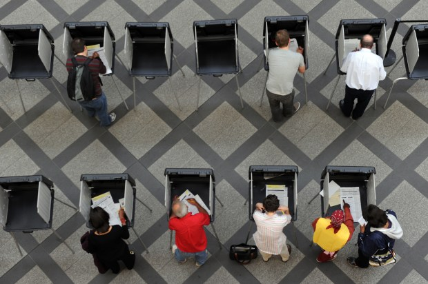 Voters cast their ballots at the Wellington E. Webb Municipal Building in Denver on July 6, 2016.