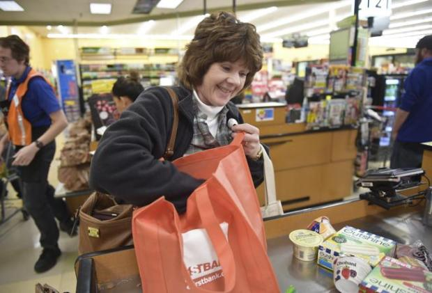 Mitzi Babb, of Gunbarrel, bags her groceries at King Soopers, 995 S. Hover St. Wednesday afternoon.