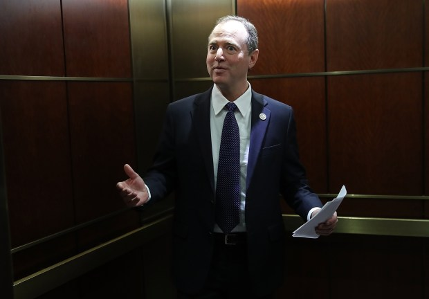 WASHINGTON, DC - FEBRUARY 05: Rep. Adam Schiff, the ranking Democrat on the House Intelligence Committee, answers questions from the media while boarding an elevator at the U.S. Capitol on Monday. The committee later voted to release the Democrat rebuttal to a memo released last week by their Republican counterparts relating the committee's investigation of Russian influence in the 2016 presidential election.