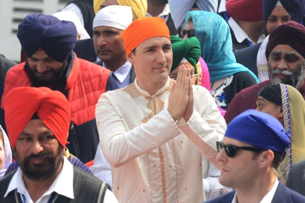 Canadian Prime Minister Justin Trudeau pays his respects at the Sikh Shrine Golden temple in Amritsar, India, on Wednesday. Trudeau and his family are on a week-long official trip to India.