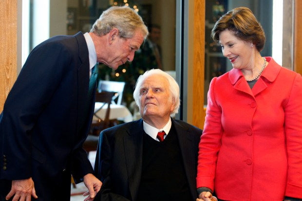 Former President George W. Bush, left, ...