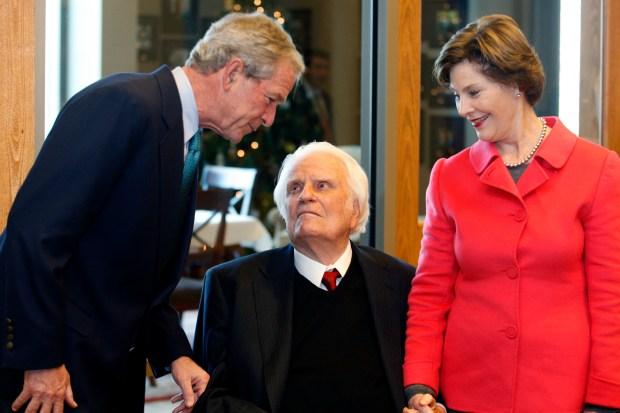 Former President George W. Bush, left, ...