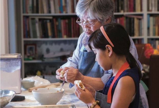 "Eleven-year-old Meilee Riddle learns to make Chinese delicacies with her grandmother, Ellen Chou, in Seattle. (Clare Barboza, from ""Chinese Soul Food"" by Hsiao-Ching Chou)"