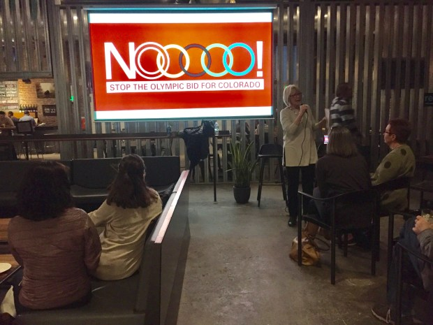 """Christine O'Connor, a Denver neighborhood advocate, speaks during a meeting of the """"NOlympic"""" group on Feb. 18, 2018, at The Source in Denver. O'Connor is a member of the Denver Olympics exploratory committee's """"Sharing the Gold"""" advisory panel."""