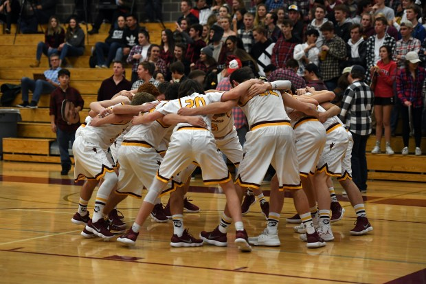 Golden boys basketball team gets ready for their game against Evergreen. Golden ex-coach, John Anderson attended the game on Jan. 24, 2018 in Golden.