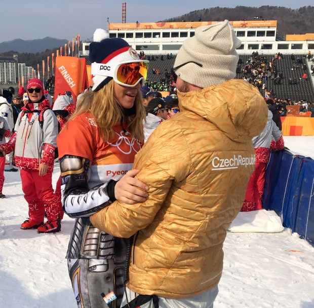 Ester Ledecka, the Czech Republic snowboarder who stunned the world when she won alpine skiing's super-G, embraces her Steamboat Springs coach Justin Reiter after winning Saturday's parallel giant slalom snowboard race.