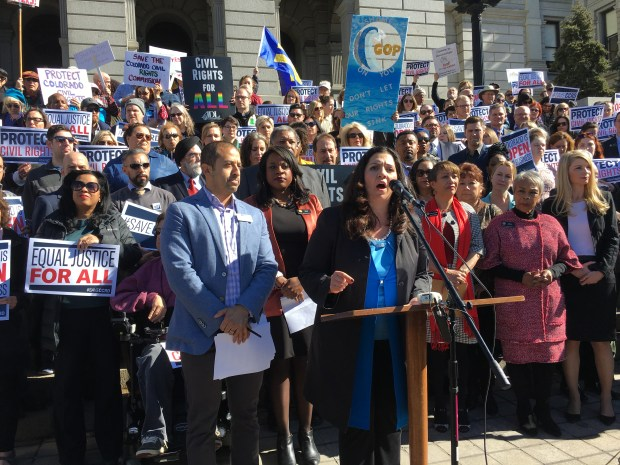 House Speaker Crisanta Duran, D-Denver, speaks as dozens rally on Tuesday at the Colorado Capitol to protect the Colorado Civil Rights Commission in an event organized by Democrats and LGBT advocacy groups. Republicans, however, say they don't want to do away with the panel.