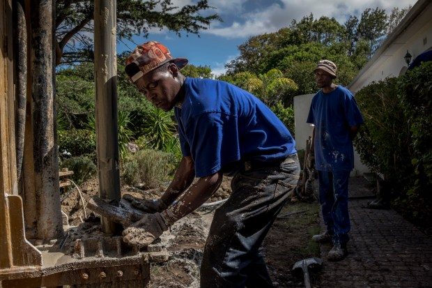 A worker drills a borehole on Feb. 16, 2018, at a home in Constantia, a Cape Town suburb.