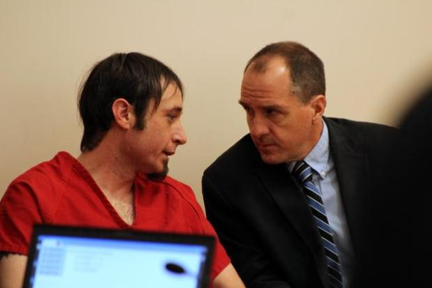 Christopher Parker, left, speaks with his lawyer, Eric Vanatta, on Tuesday morning. Parker has been charged with the shooting death of William Connole of Loveland and the attempted shooting of another man in 2015. Authorities have not connected Parker to four other random shootings that also occurred that year. (Hans Peter / Loveland Reporter-Herald)