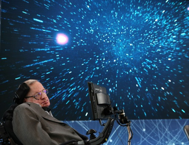 Stephen Hawking appears onstage during the announcement of a space exploration initiative on April 12, 2016, in New York City. The renowned British physicist died on Wednesday at his home in Cambridge.