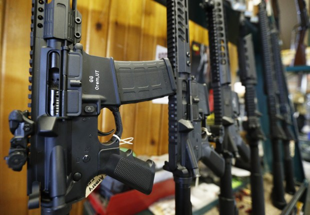 AR-15s are displayed at Good Guys Guns & Range in Orem, Utah, on Feb. 15.