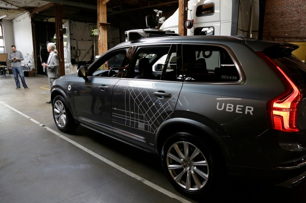 In this Dec. 13, 2016 file photo, an Uber driverless car is displayed in a garage in San Francisco. Uber suspended all of its self-driving testing on Monday after what is believed to be the first fatal pedestrian crash involving the vehicles. Police in a Phoenix suburb said one of its self-driving vehicles struck and killed a pedestrian overnight Sunday.