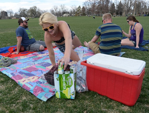 Mercedes Gray, center, and friends enjoyed beers at Washington Park on April 9, 2014.