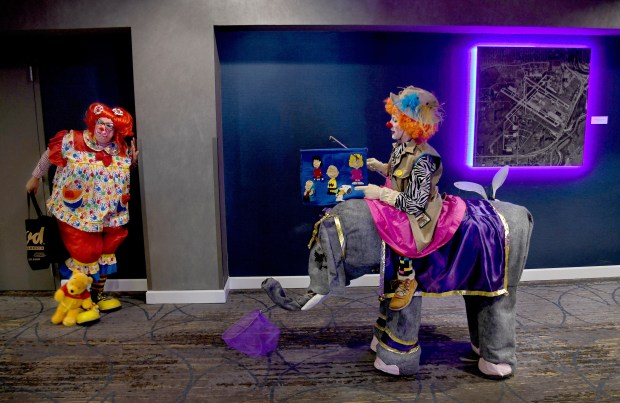 """Robin """"Pinkie Bee'"""" Bryan of Jacksonville, Fla., left, and Kristine """"Lilleigh"""" Dietrich of Menomonee Falls, Wis., wait in the hotel hallway for the paradability contest. Top contenders later entertained at the nearby Mall of America."""