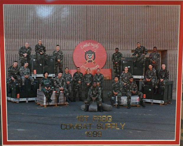 This is a copy photo of a photo of the Marine Corps 1st FSSG Combat Supply 7th Engineers unit of which Eddie Moreno was a part, in 1999 taken at his home on March 25, 2018 in Brighton.