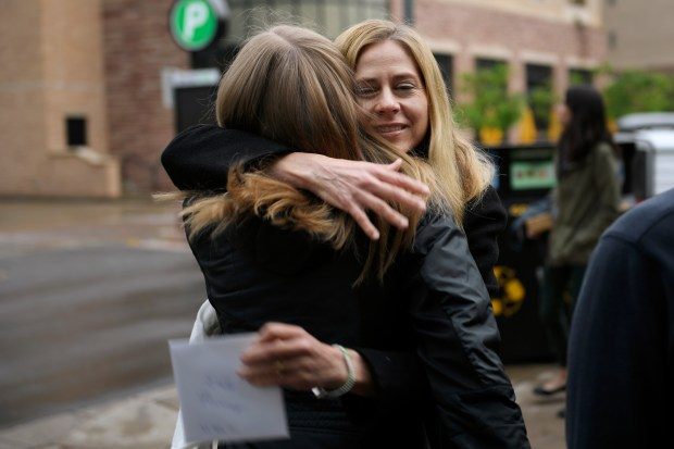 Emily Murray, 20, a junior at CU Boulder is hugged by Jennifer Pennell as they met to celebrate Murray's 20th birthday on May 20, 2018 in Boulder, Colorado. Murray celebrated her birthday with her foster family, Marcus and Jennifer Pennell and their daughter Amelia, 12, at the Brasserie Ten Ten restaurant in Boulder.