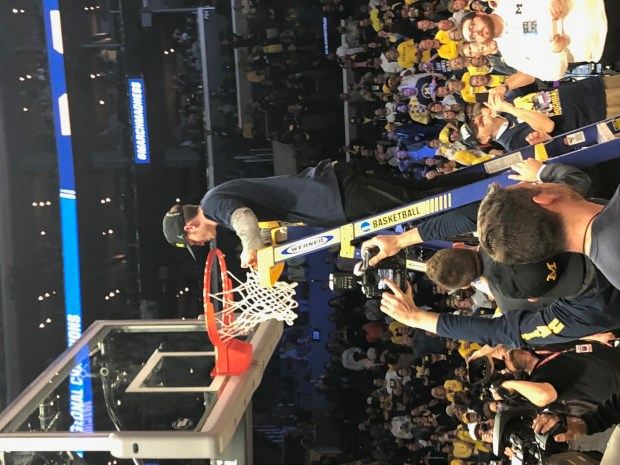 Former Boulder High School basketball player Luke Wilson cuts down the net at Staples Center as a walk-on at Michigan. Photo provided by Sandy Wilson.