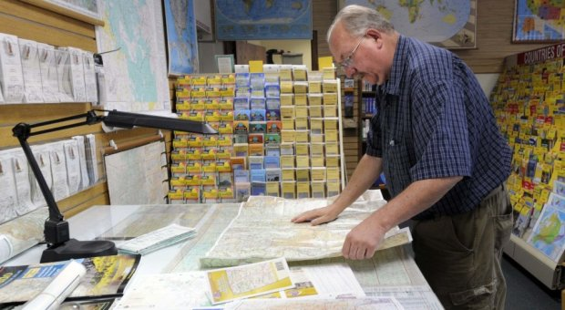 Bob Stanley a distribution manager with MacVan Maps says the USGS terrain maps of the Waldo Canyon Fire are popular. He had to order more to keep them in stock.