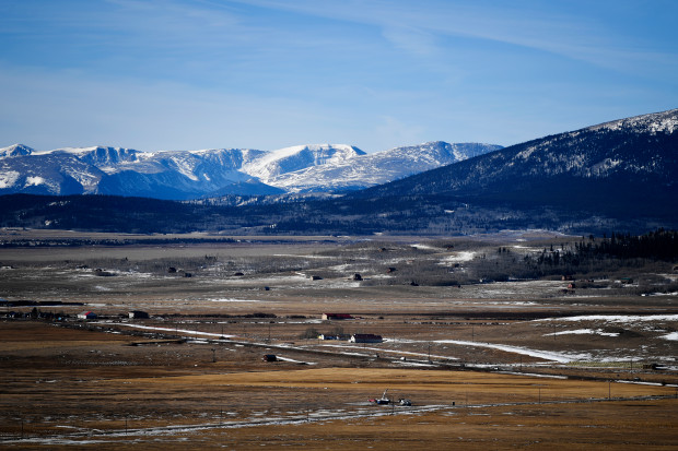 Colorado's shrinking mountain snowpack has forced an expanded federal drought designation covering nearly a quarter of the state.