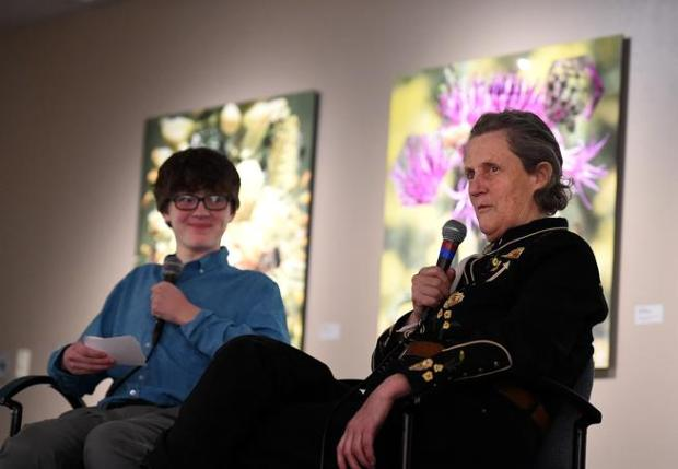 Temple Grandin answers questions about autism and her life Tuesday during an interview with Trust Decatur, 13, left, of Fort Collins, at the Loveland Museum/Gallery in downtown Loveland. Trust, who is on the autism spectrum, asked Grandin questions before she took questions from the audience.