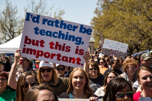 Oklahoma teachers and their supporters protest on Wednesday in front of the state Capitol in Oklahoma City. They are demanding increased school funding and pay raises for school workers.