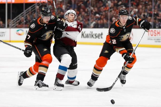 Anaheim Ducks' Josh Manson, right, chases ...