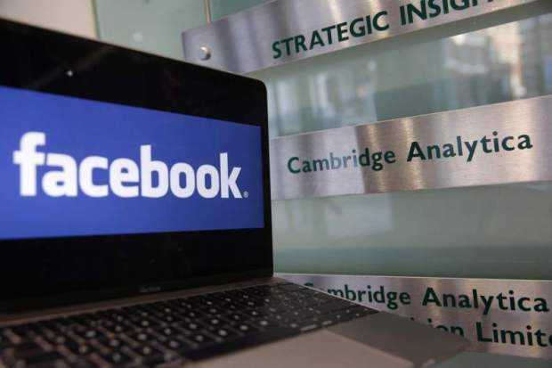 A laptop showing the Facebook logo is pictured at the offices of Cambridge Analytica in London last month.