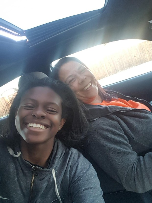 "Gabriella Shead, a Lakewood resident, snaps a selfie on Tuesday, April 3, 2018 with her HopSkipDrive CareDriver Angela Coleman during the Los Angeles-based company's first week in Denver. The ride-sharing service focuses on shuttling unaccompanied minors ages six and up in a ""Uber-for-kids"" like service. Drivers go through fingerprint background checks and must have five years of child care experience."