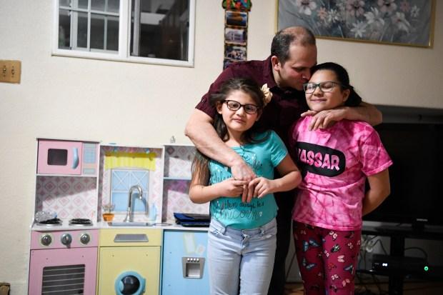 Rudi Lopez-Cordova hugs his daughters, Allison ...