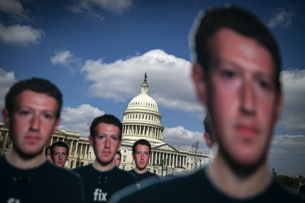Cutouts of Facebook's Mark Zuckerberg are displayed near the Capitol in Washington, D.C., on April 10, 2018.