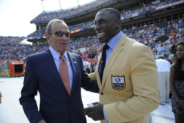 """Denver Broncos Hall of Famer Shannon Sharpe talks with team owner Pat Bowlen as Sharpe is honored with his """"ring of fame"""" at half time of the Denver Broncos game against the Cincinnati Bengals on Sept. 18, 2011 at Sports Authority Field at Mile High."""