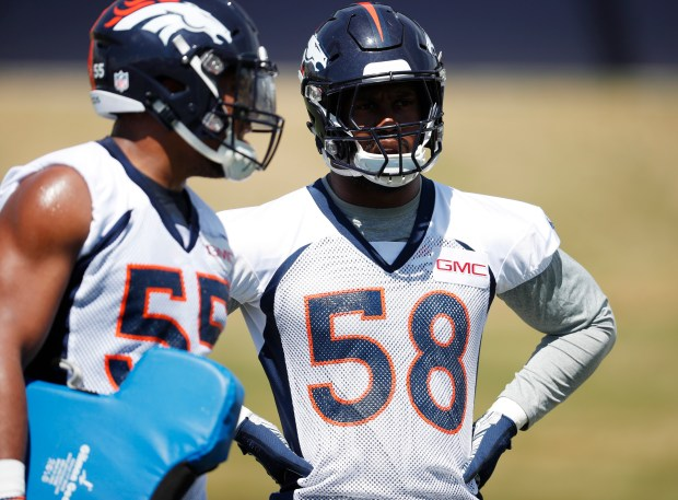 Denver Broncos linebacker Bradley Chubb, left, ...