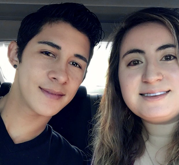This undated photo provided by Yaritza Moreno shows Moreno, right, with her husband Samuel Pensamiento, an immigrant living in the U.S. illegally who had been charged with leaving an accident and blocked from appearing in court until the American Civil Liberties Union of Massachusetts intervened.
