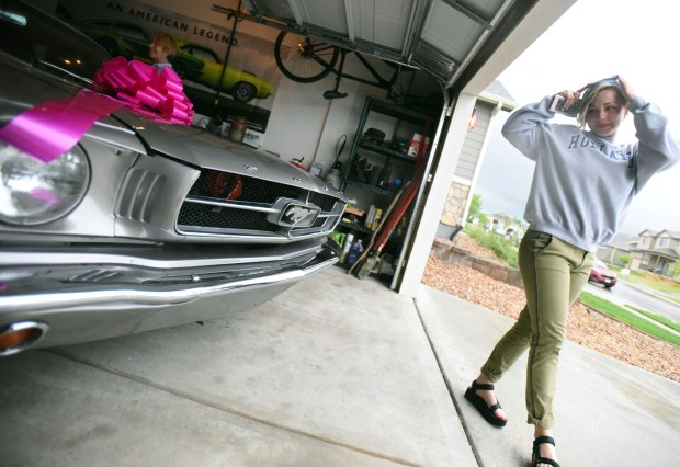 "Layne Pachl walks around her new car in Greeley, Colo., May 18, 2018. Though Sandi Elder knows better, she has an occasional nickname for her husband: She calls him ""Stoic 'Ole Willie."" You might not ever get to see the Tootsie Roll under that hard exterior, unless you mention Layne Pachl, the 20-year-old who saved Sandi's life. Then Willie starts crying."