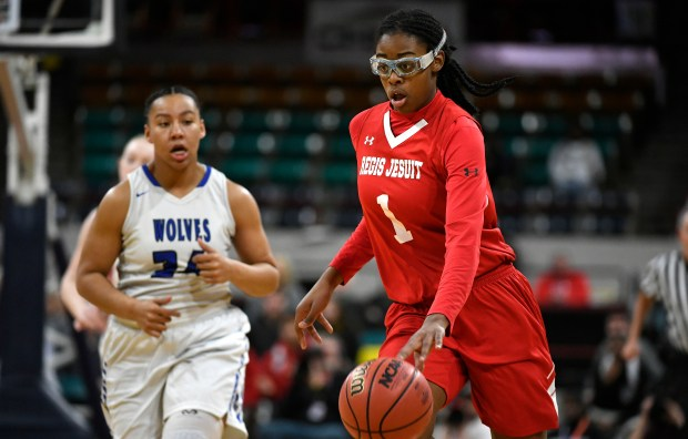 Regis Jesuit forward Francesca Belibi (1) drives the ball up the court during the 1st half of the 5A girls state championship basketball game at the Denver Coliseum on March 10, 2018 in Denver, Colorado. The Grandview Wolves beat the Regis Jesuit Raiders 67-61.