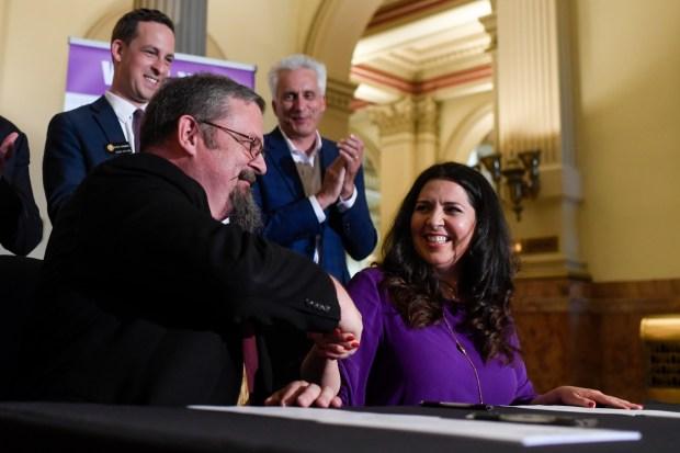 Senate President Kevin Grantham shakes hands ...