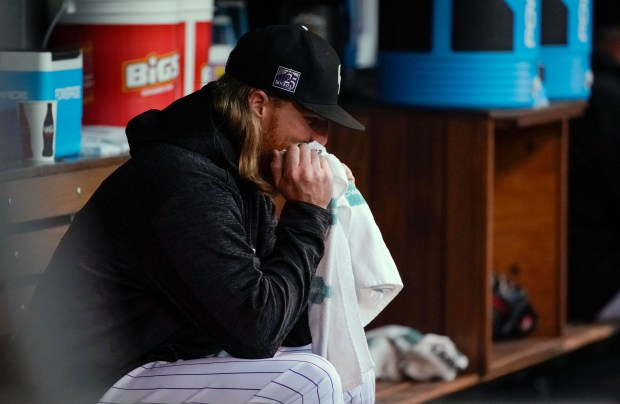 Colorado Rockies starting pitcher Jon Gray reacts in the dugout after being pulled during the fourth inning of the team's baseball game against the San Francisco Giants on Wednesday, May 30, 2018, in Denver.