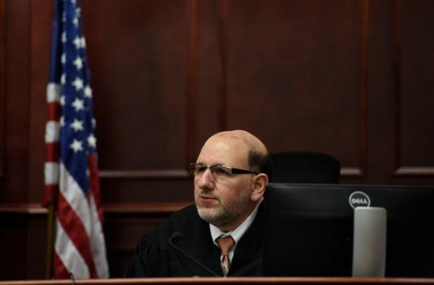 Judge Carlos A. Samour Jr. sits ...