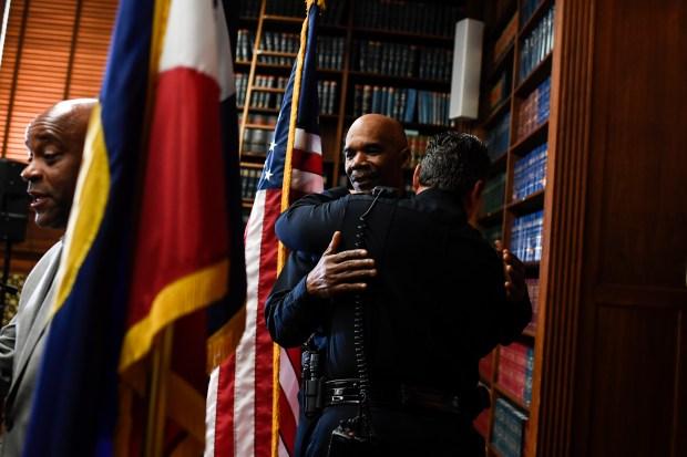 Chief Robert White hugs Commander Paul ...