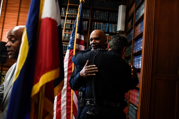 Chief Robert White hugs Commander Paul ...