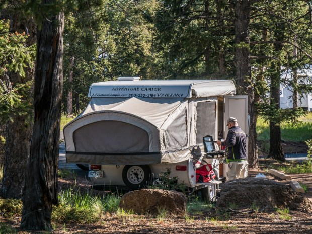 A camper fixes breakfast in the Mueller State Park campground near Divide.