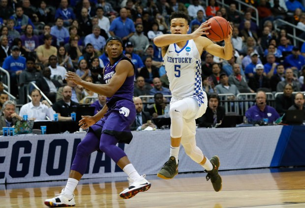 Kevin Knox (5) of the Kentucky Wildcats handles the ball against Xavier Sneed (20) of the Kansas State Wildcats in the first half during the 2018 NCAA Men's Basketball Tournament South Regional at Philips Arena on March 22, 2018 in Atlanta.