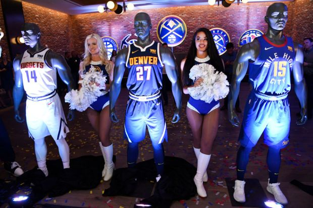 Denver Nuggets dancers Ashley, left, and ...